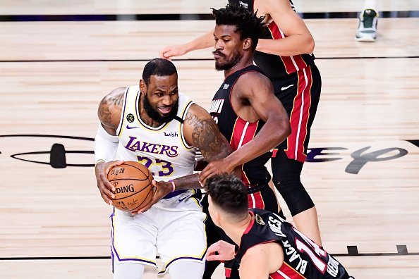 LeBron James of the Los Angeles Lakers drives the ball against Jimmy...