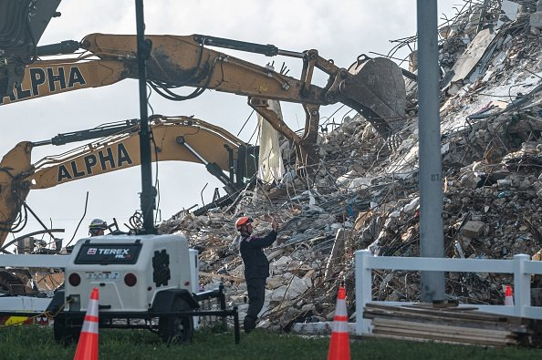 Bulldozers clear debris