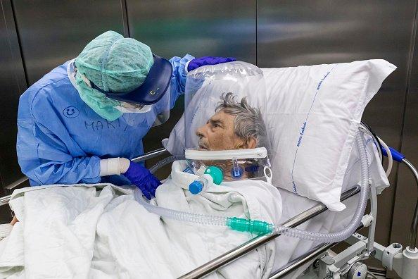 Patient in Italy wears CPAP helmet