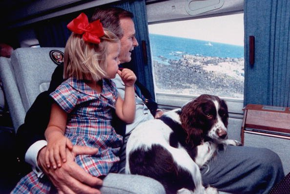 President George Bush in flight with family dog