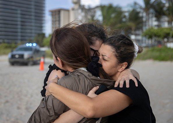 Three women share a hug