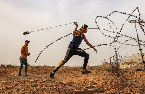 Palestinian Protester Uses a Slingshot