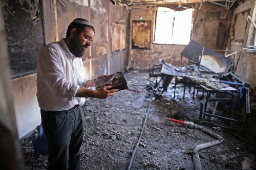 Rabbi Inspects Interior of Torched Religious School
