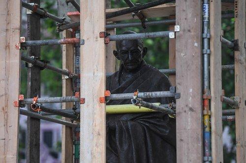 Protective barrier aroundMahatma Gandhi statue