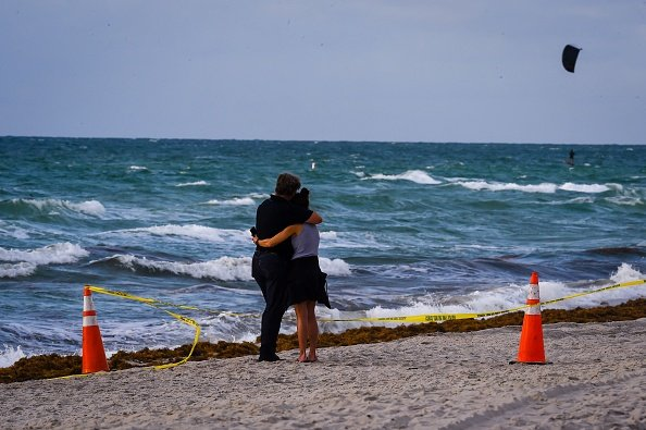 A couple seeks comfort
