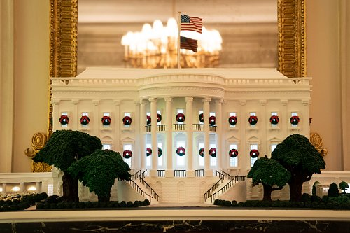 A White House gingerbread house is displayed in the State Dining Room
