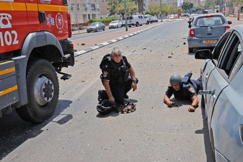 Israeli Security Forces Take Cover From Rockets