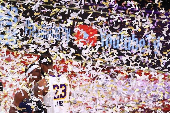 LeBron James of the Los Angeles Lakers hugs Rajon Rondo of the Los...