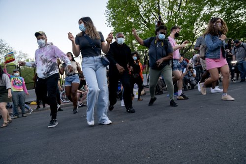 Demonstrators dance in D.C.