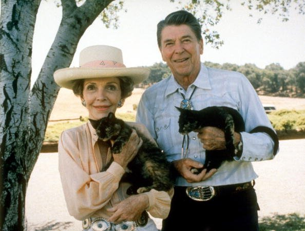 President Ronald Reagan and wife Nancy holding Cleo and Sara