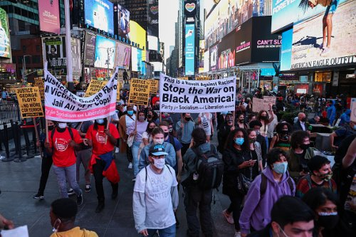 Hundreds march in Times Square