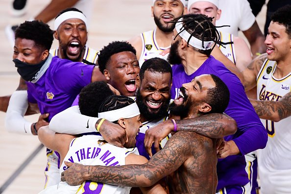 LeBron James of the Los Angeles Lakers celebrates with Quinn Cook of...