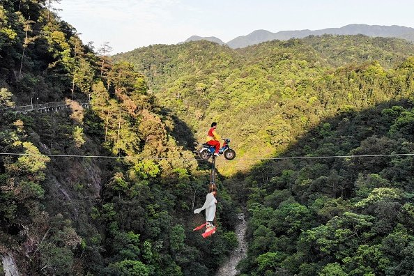 Motorcycle over a canyon in Hunan