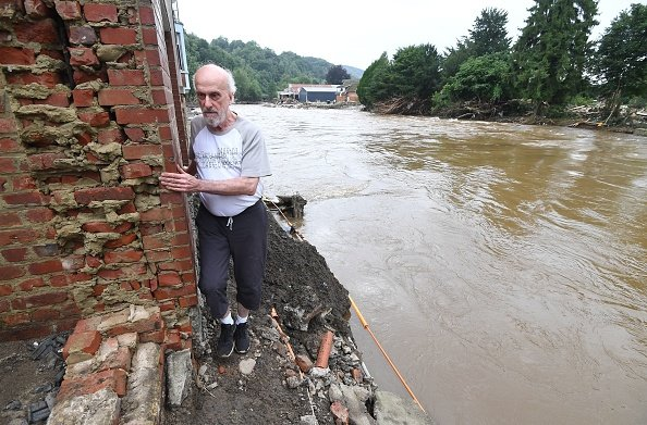 Resident exits his home in Belgium