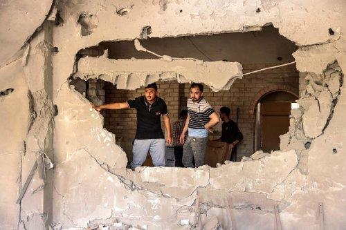 I danni di un attacco aereo israeliano alla Banca Nazionale Islamica