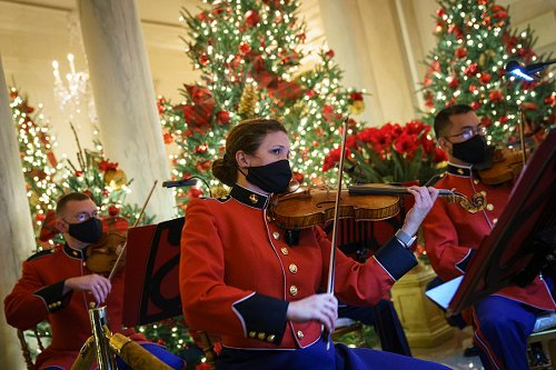 A military band plays Christmas music in the Grand Foyer