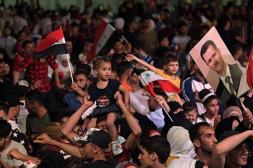 Festeggiamenti per  la quarta rielezione del presidente della Sira  Bashar al-Assad