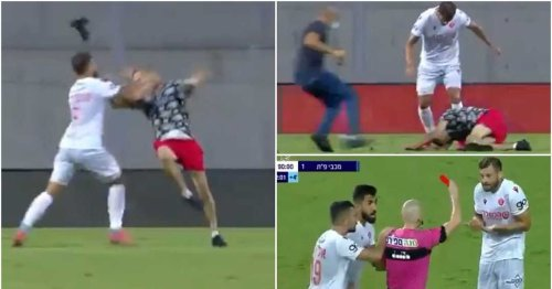 Crazy footage shows Hapoel Tel Aviv player being sent off for striking a pitch invader