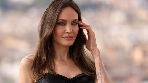 Angelina Jolie Is the Epitome of a Movie Star in This Shimmery, Strapless Versace Gown