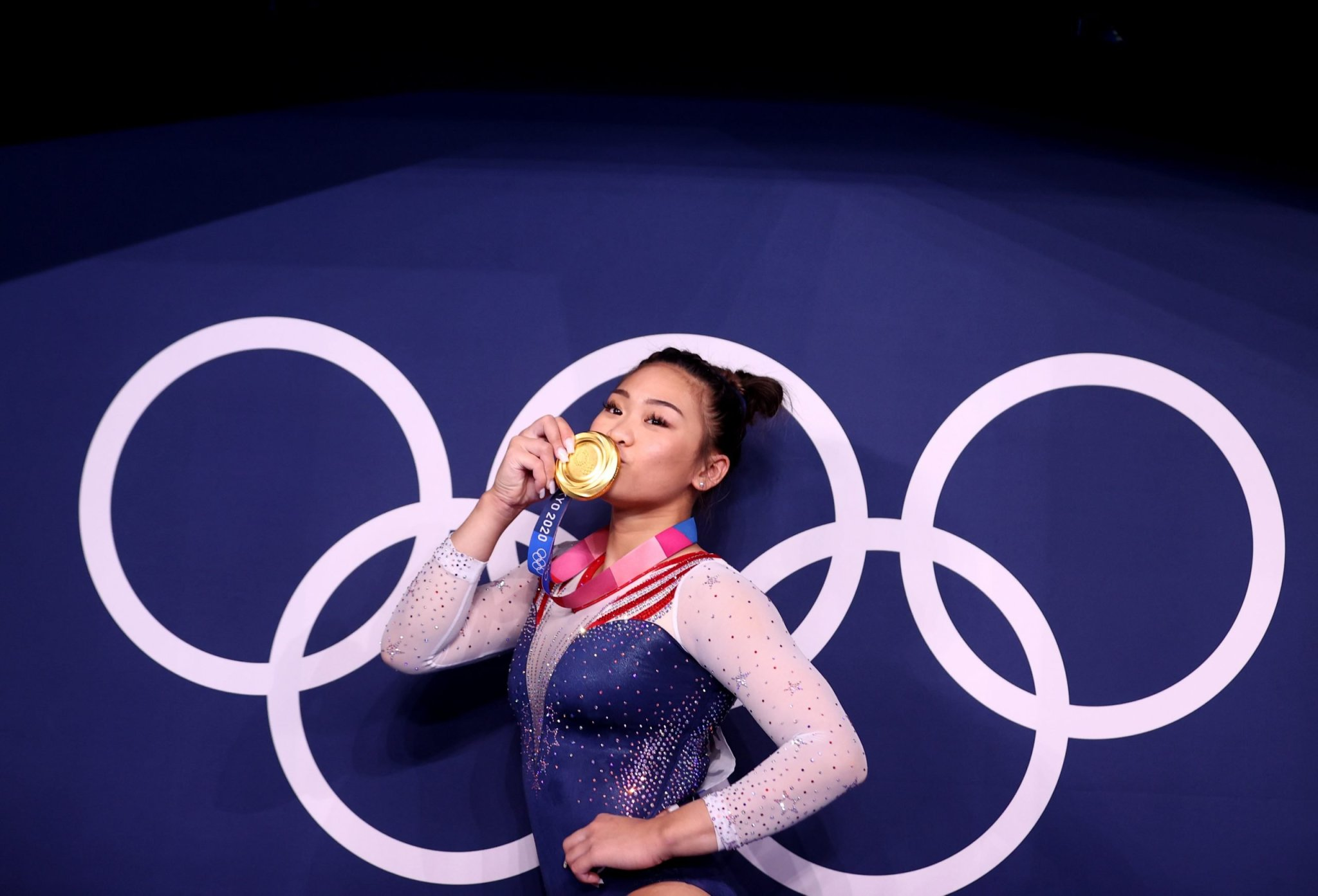 Gymnastics-USA's Lee taking gold home to her father and Hmong community