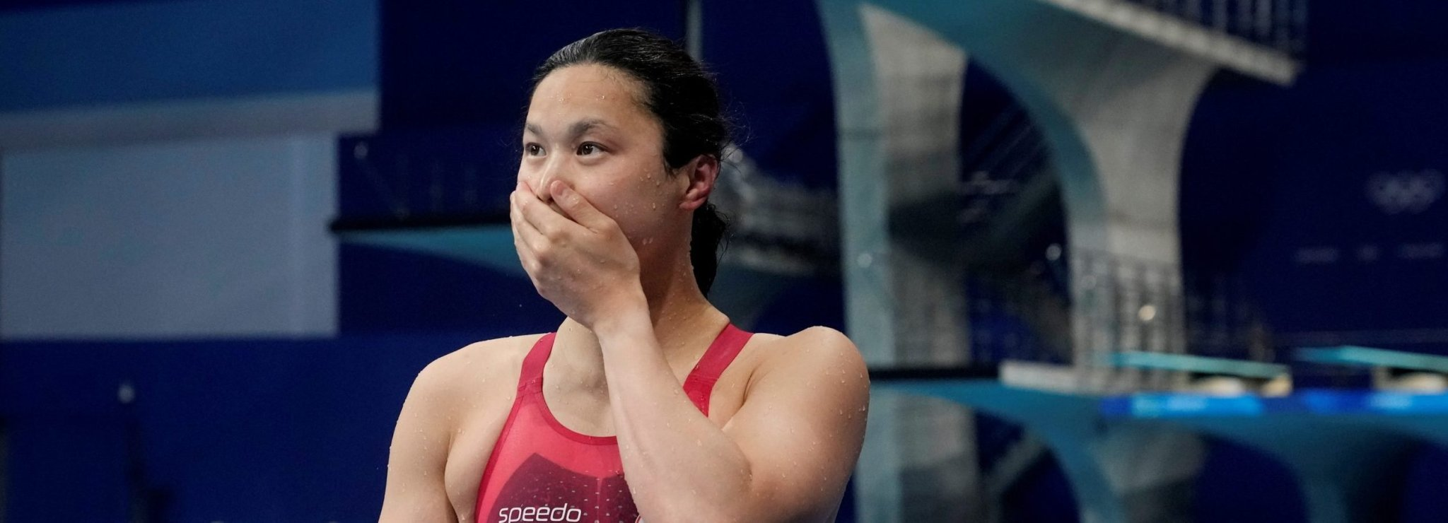 Olympics-Swimming-Out of sight! Canada's MacNeil wows rivals in 100m fly