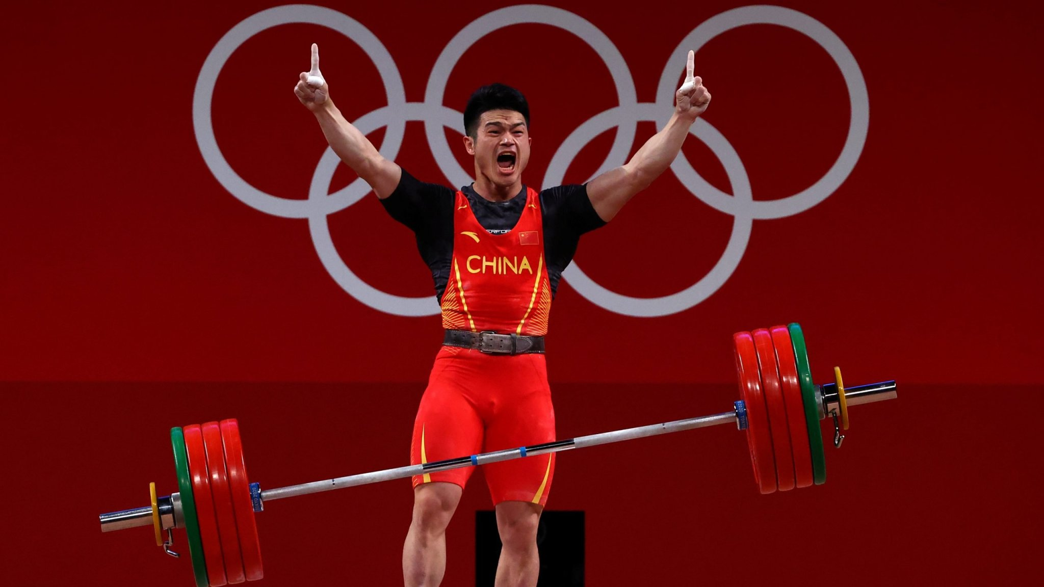 Olympics-Weightlifting-China's Shi breaks world record to win gold in 73kg