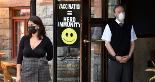 Canada tops world in vaccinated population as new COVID-19 cases fall below 1,000