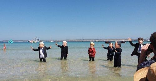 Why protesters waded into Cornish sea wearing Boris Johnson masks