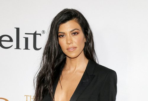 Kourtney Kardashian Gives Us A Peek Up Her Skirt In Sultry New Post