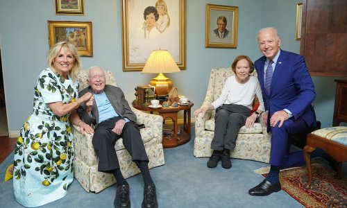 Why do the Carters look so tiny alongside Joe Biden and his wife Jill in this picture?