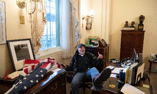 'It's not fair!' Capitol suspect who put feet on Pelosi's desk has court outburst