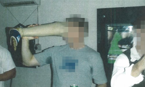 Photo reveals Australian soldier drinking beer out of dead Taliban fighter's prosthetic leg
