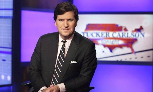 Lachlan Murdoch backs Tucker Carlson in 'white replacement' furore