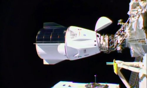 SpaceX Dragon capsule docks with the International Space Station