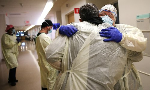 US coronavirus death toll passes 500,000 after devastating winter surge