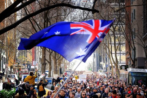 Who's behind Australia's anti-lockdown protests? The German conspiracy group driving marches
