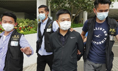 Hong Kong police arrest editor-in-chief of Apple Daily newspaper in raids
