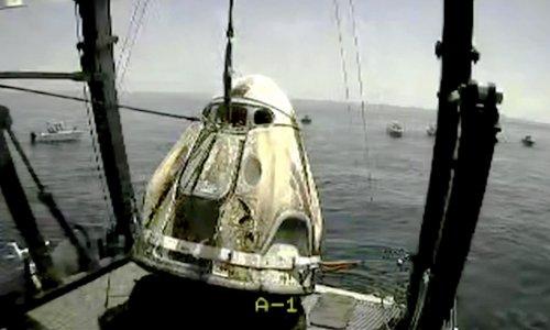 Nasa astronauts aboard SpaceX capsule make first splashdown in 45 years
