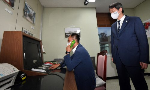 South and North Korea restore hotline after a year on hold