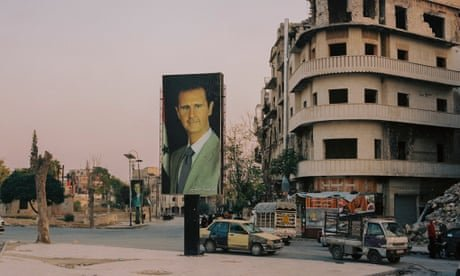 The 'doctor' keeps watch: Assad posters loom over shattered Syria – in pictures