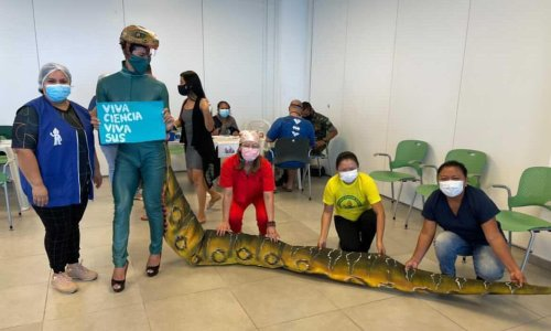Angry Brazilians dress as reptiles for their Covid jabs to mock Bolsonaro