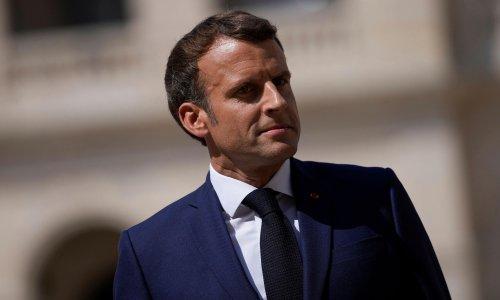 Emmanuel Macron takes legal action over Hitler poster comparison