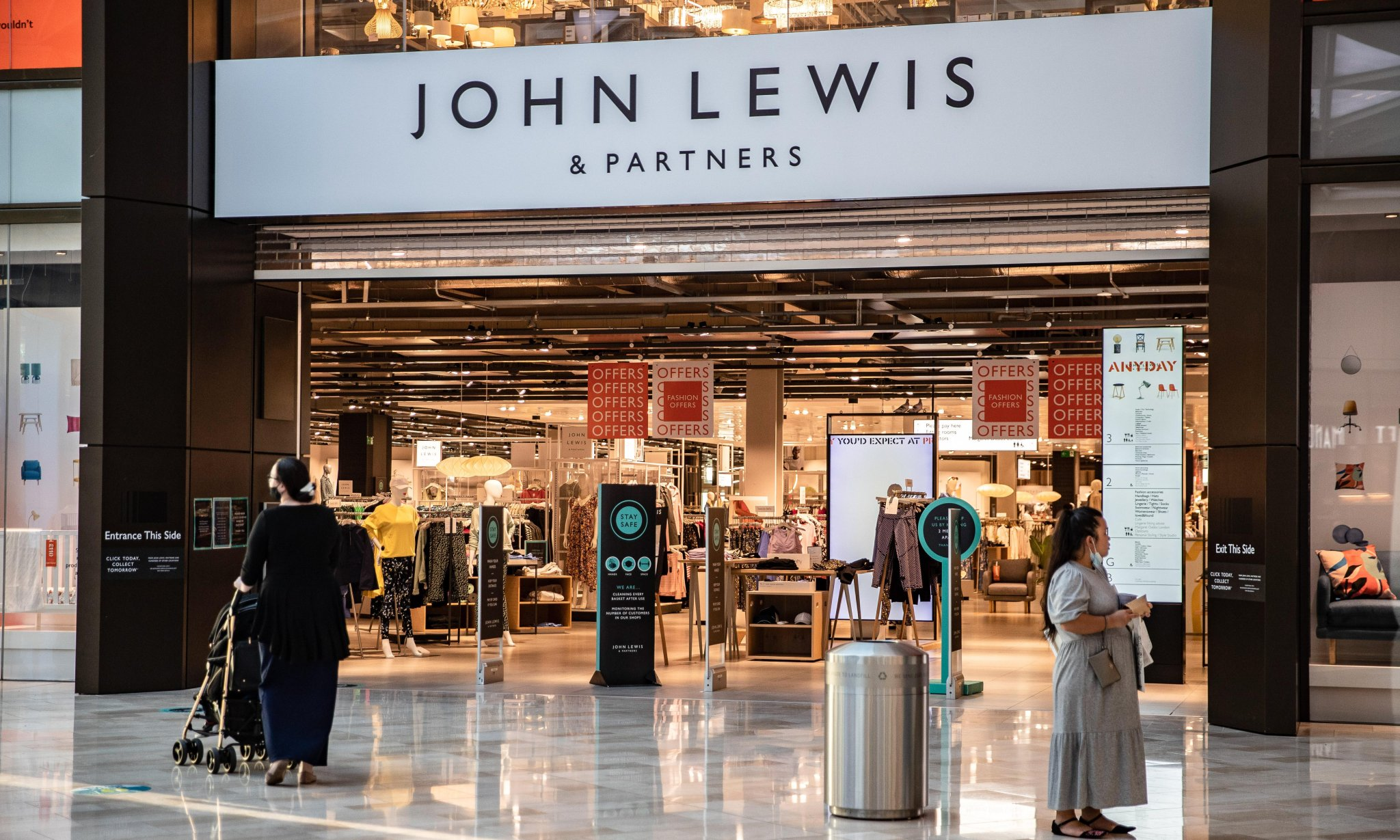 John Lewis cuts losses to £29m but warns of Christmas uncertainty