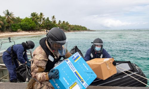 Inflatable dinghies and Zoom medical training: how a remote Pacific atoll got Pfizer