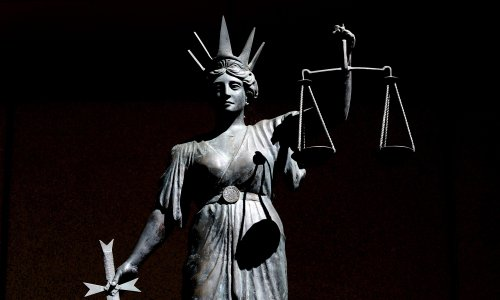 Sydney barrister avoids fine for simulating oral sex with female clerk in 'ritualised greeting'