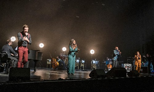 Songs for a New World review – singers face forwards in bold, Covid-safe show