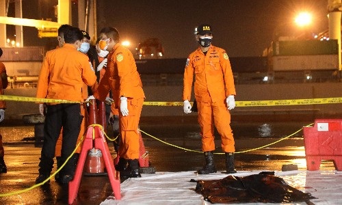 Search resumes for Boeing 737 carrying 62 people feared to have crashed into sea near Jakarta