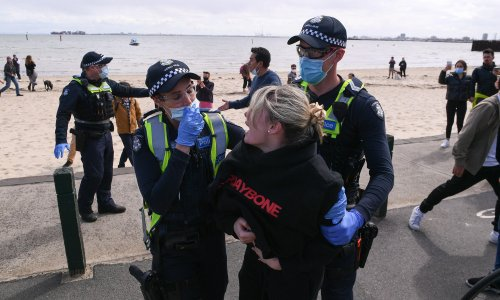 Victorian Covid cases surge to new record as protesters arrested and NSW warns of undiagnosed deaths