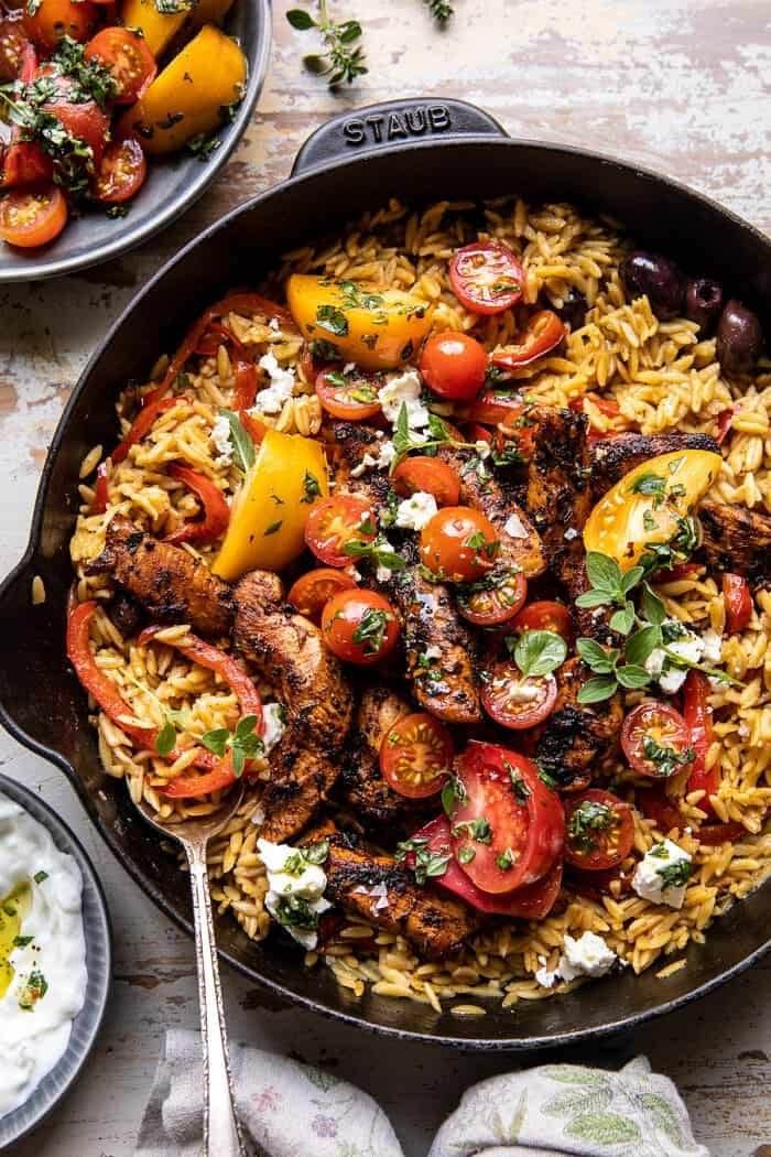 One Skillet Greek Chicken and Orzo with Tomatoes, Feta, and Tzatziki.