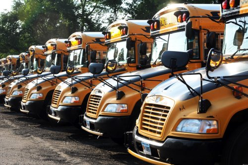 Driver stabbed, killed on school bus with students aboard